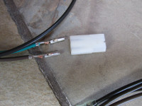 Fit Molex plug after routing wires through hole in headlight bucket.