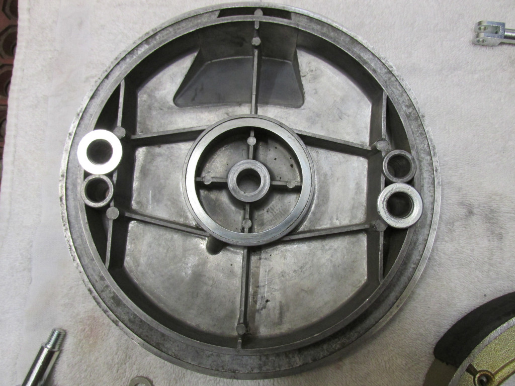 The inside of the brake plate with the large flat washers positioned where the rotating pivots will be inserted.