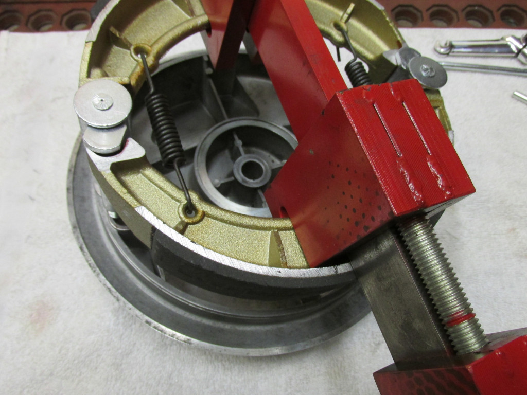Here is Stephen Brenton's excellent brake shoe spreader tool in place. Please note the orientation of the springs. The open ends of the springs facing down/away from the wheel hub to avoid any risk of them spreading wide and coming into contact with the rotating wheel.
