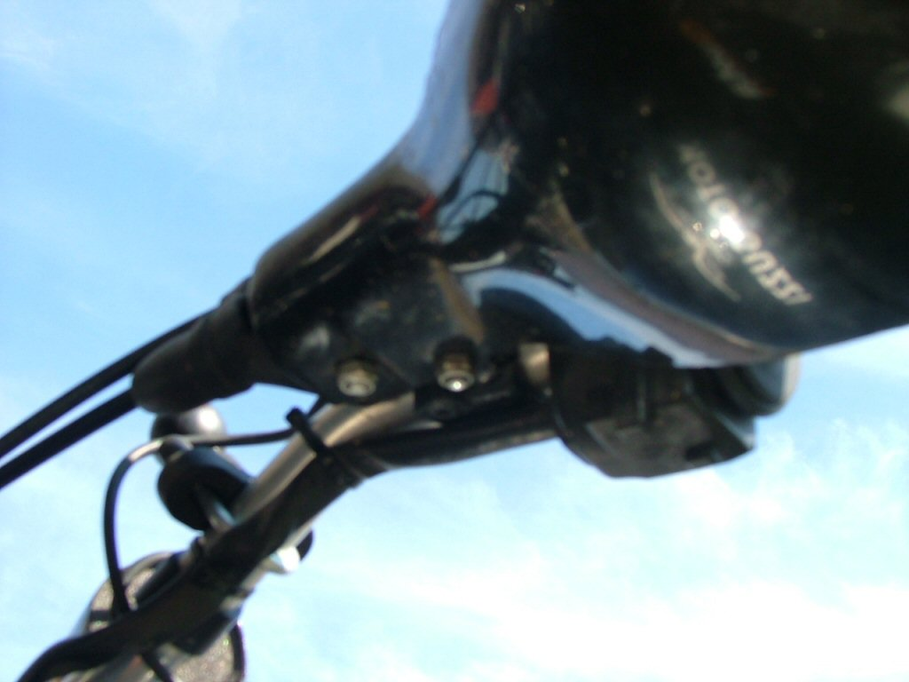 Underside of left guard showing two nylock nuts on pivot bolt and stabilizer bolt. Mounting Triumph Tiger hand guards on a Moto Guzzi Quota 1100 ES.