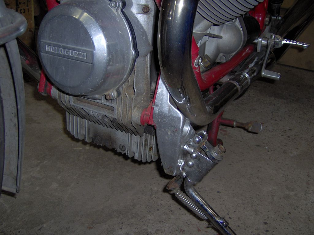 Side stand bracket enabling the fitment of a long side stand on a Moto Guzzi 850 T.